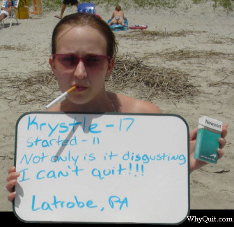 Photo of 17 year-old Krystle, a NewPort smoker who started smoking at age 11, holding a sign.  It reads, 'Not only is it disgusting, I can't quit!!!'
