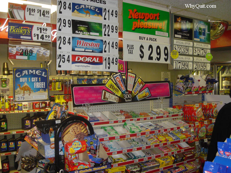 Picture showing how convenience stores use M&M's, Snickers and Hersey's candy as bait to entice children and teenagers to experiement with smoking.