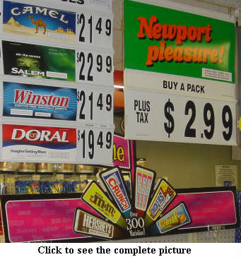 Image showing cigarettes being sold above candy