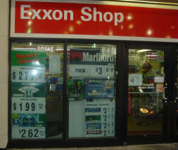 Exxon store windows filled with cigarette ads