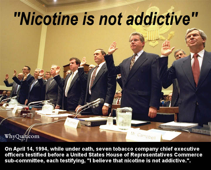 Photo of 7 tobacco company CEOs being sworn in before testifying before a U.S. House committee on April 14, 1994 that nicotine is not addictive.