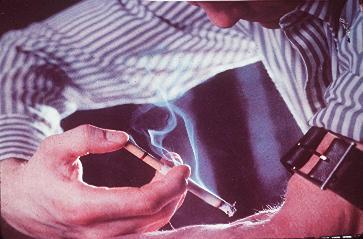 Picture of a man injecting a cigarette into his arm