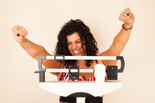 picture of woman excited smoking cesssation weight control. Photo courtesy of the U.S. NCI.