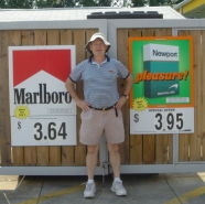 Click to enlarge this August 8, 2009 image of John R. Polito standing in front of convenience store Marlboro and Newport signs in Ladson, SC