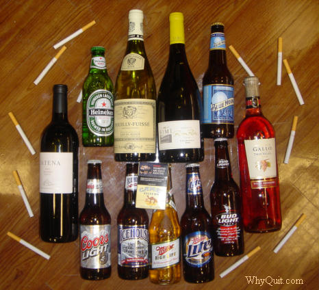 various brands of beer and wine bottles surrounded by cigarettes