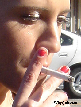 smoker taking a puff off of a cigarette