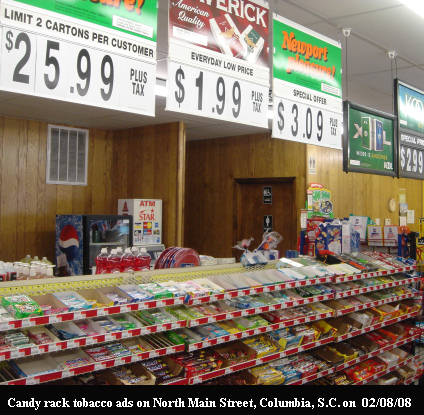 Tobacco ads hanging above candy racks are not there by chance yet elected leaders remain silent.  Why?