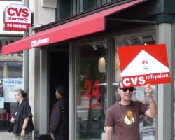 Photo of Dr. Gerace carrying his sign while protesting in front of CVS