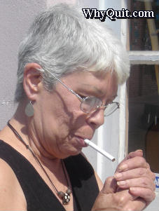 picture of a smoker lighting a cigarette
