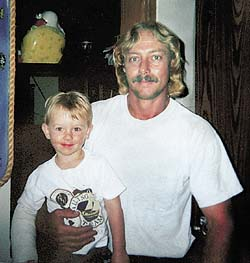 Bryan Lee Curtis holding his two year-old son Bryan Jr., just 63 days before his death